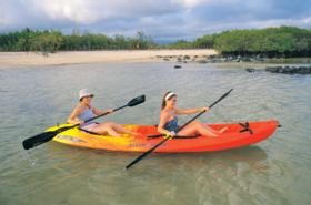 Enjoy kayaking along the white coral beach in front of the Finch Bay Eco-Hotel