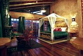 Standard Room: 650 square feet with a king-size canopy bed facing a grand gas fireplace, Peace Lodge, Costa Rica